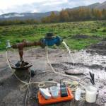 Figure 2. Measuring groundwater chemistry at a newly drilled well.
