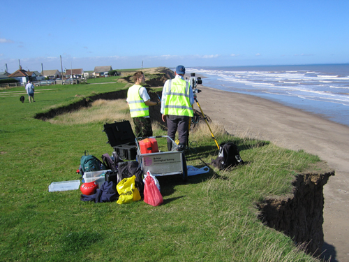 BGS staff scanning the cliff from above.