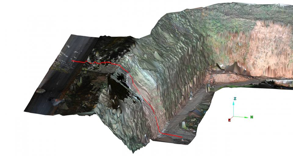 LiDAR scan showing the location of cross section in Figure 6b in red © BGS. N.B. This survey was carried out after the landslide debris had been removed.