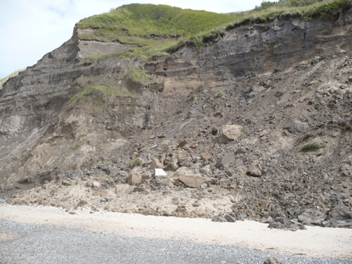 Failure of material from the cliff in Nefyn Bay.