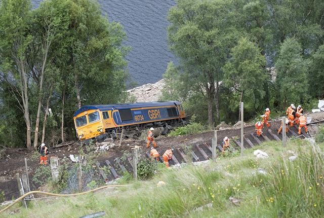 Derailed engine below the rail track.