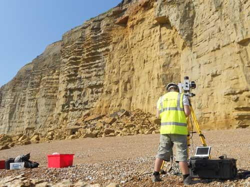 The British Geological Surveys' Landslide Response Team map the collapsed cliff from a safe distance using a LiDAR, laser, scanner. Taken 25 July 2012.