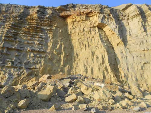 The British Geological Surveys' initial findings suggest the recent heavy rain was a contributing factor that caused the rock fall at Barton Bradstock. Taken 25 July 2012.