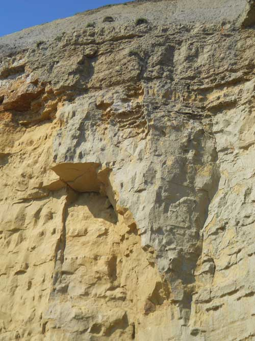 The presence of wide open cracks in cliff face provides a natural warning sign that cliffs may be unstable and potentially dangerous. Taken 25 July 2012.