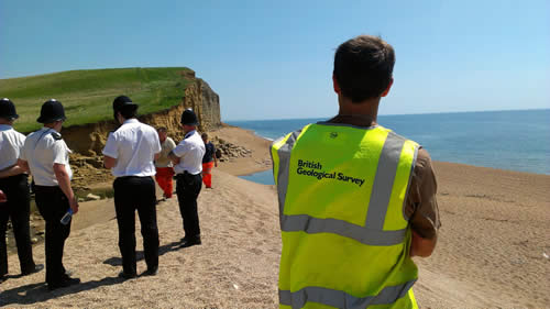 On 25 July 2012, the BGS Landslide Response Team waiting for access to the beach to carry out a survey of the landslide.