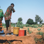 Pumping drinking water from a shallow groundwater source in Tanzania