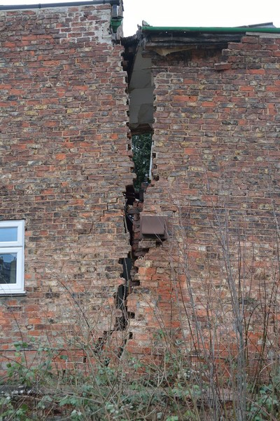 Damage caused to No 26 Magdalen's Close by sinkhole that developed on Monday 17 February 2014.
