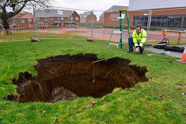 Rainham Mark Grammar School: surface expression of denehole collapse that occurred on 12 February 2014.