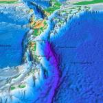 A 3D model of the Puerto Rico Trench, with the Caribbean to the left shown in blue, the trench in thje middle shown in purple and the Atlantic plat to the right shown in blue