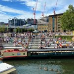 People on the steps at Regent's Canal, Granary Square, King's Cross, London. Source: VVShots/iStock 2020.
