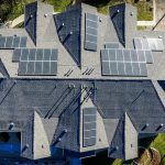 An aerial view of solar panels on top of houses